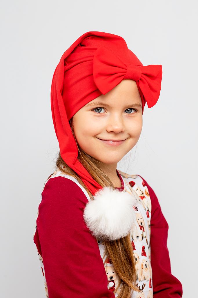 Tyttö punainen tonttulakki päässä